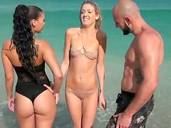 Couple of juice beach babes having fun showing off their butts