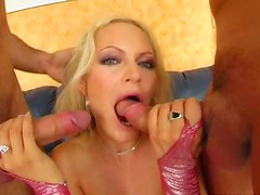 Restless blonde mistress gets wild sucking two huge shaved dicks