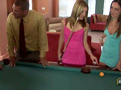 Two sexy bitches suck pricks and get fucked after playing pool