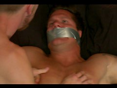 Hunk with chiseled abs toys with a kinky twink in this bondage scene