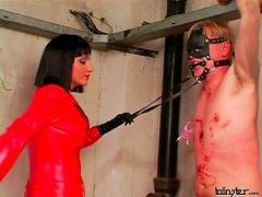 Red leather catsuit on abusive mistress