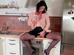 Juicy brunette MILF housewife plays with dildo in the kitchen