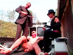 Guy bound in the back of a truck is abused