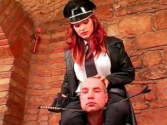 Prisoner and his stunning mistress boot play