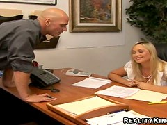 Busty blonde Abbey Brooks jumps on a cock in an office and moans loudly