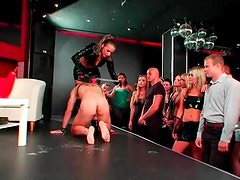 Latex mistress abuses cock and balls in front of audience