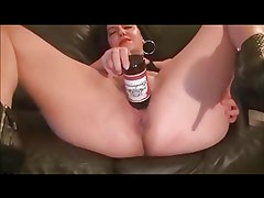Dancing milf inserts beer bottle & squirts her love juices
