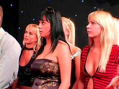 Mistress puts on femdom show for an audience