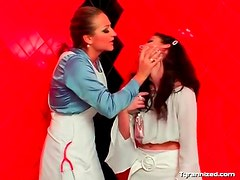 Mistress hoses down a sexy girl as she moans