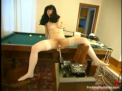 Brunette Lulu gets drilled by a machine on a sofa