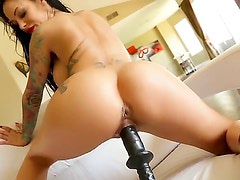 One of a kind tattooed sexy whore Angelina Valentine with long black hair and gigantic fake