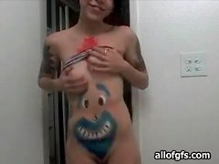 Teen camgirl shows off body paint and tattoos