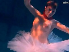 Ballerina in a tutu filmed underwater