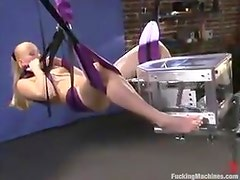 Booty blondie gets poked by a machine from behind