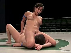 Isis Love is fucking Thea Marie with a huge strapon