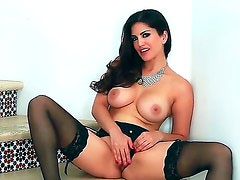 Glamour puss Sunny Leone looks awesome dressed up only in her sexy black lingerie and high heel shoes. watch and listen and