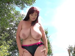 Joanna Bliss makes it rain on her huge boobs and