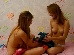 Smiling cute teens play with small tits and rub each other's clits for delight
