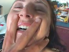 Busty ugly pale whore kneels down to provide a lucky dude with a blowjob