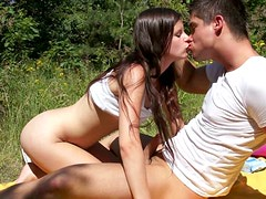Teen couple fucking outdoor on a loan in a public park