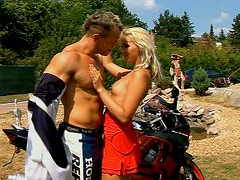Awesome tanned slender blondie seduces a biker to get her pussy rubbed