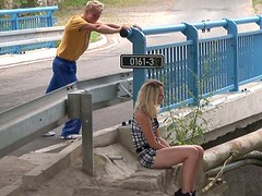 Russian blond chick Nina is stroking hard stick outdoor