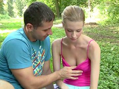 Shaved pussy of Angel is fondled actively in the park