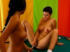 Booty teen fucks her girlfriend on the  billiard table with cue