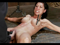 Torturing Asian Tia Ling with pleasure by toying her while chained