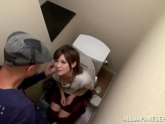 Pretty Japanese girl give a blowjob in a toilet cabin