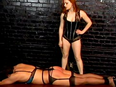 Slave in stockings gets spanked while tied