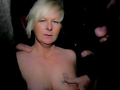Dogging MILF takes on a group of dudes