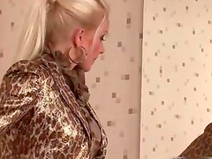 Two horny babes sucking big dick trough