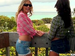 Emily Briar shares a long double dildo with some pretty girl