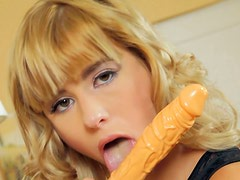 Versatile blond wanker uses a dildo to polish her wet cunt from behind