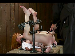 Redhead Marie McCray gets her pink pussy toyed in bondage session