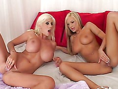 Horny blondes play with one another and a big cock