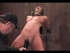 Submissive girl gets her pussy licked and toyed in BDSM video