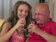 Slim girl drinks champagne and fucks old bald man