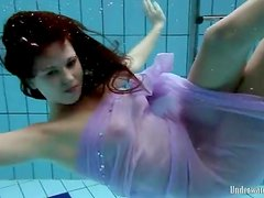 Purple dress falls off brunette in the pool