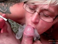 Smoking babe gives blowjob to uncut cock