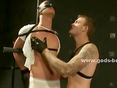 Blindfolded male slave gets his cock and balls bound in rope by his Master who clamps his nipples