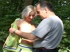 Jogging sporty blondie Tatiana sucks the cock of old man Dirk in the park