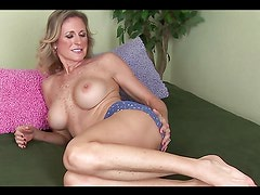 Mature slut inserts cock-shaped dildo in her cunt!