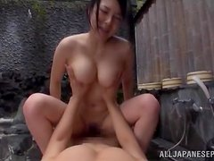 Outdoor sex in the sauna with a busty Japanese hun
