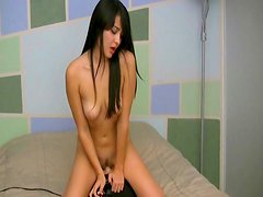 Alluring dark-haired model is riding on the rubber dick