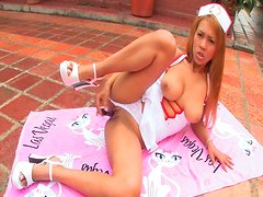 Nurse shows her nice shaved pussy