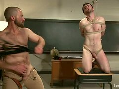 Spanking and Fucking Action in Gay BDSM Video in Classroom