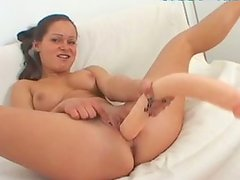 Flexible booty brunette Wibeke uses a huge dildo while masturbating madly