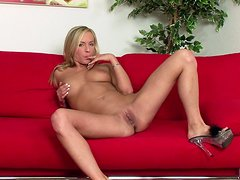 Gorgeous blond angel is touching her wet beaver